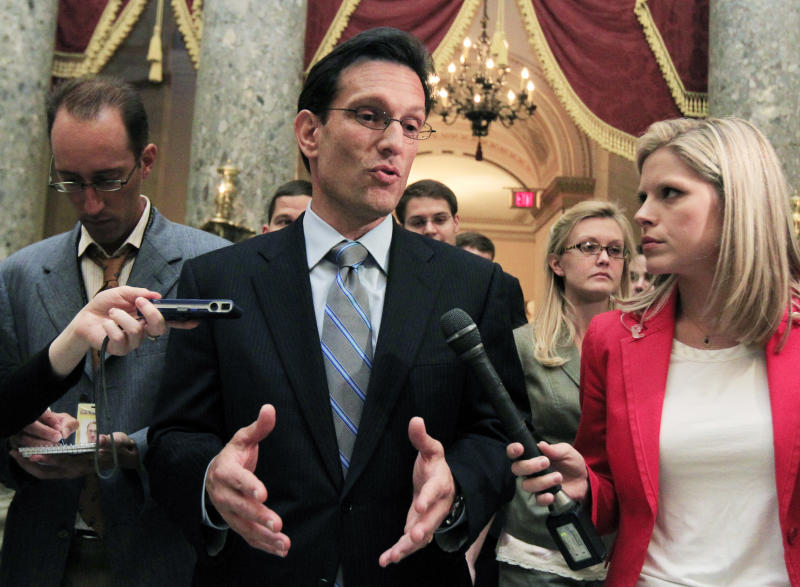 House Majority Leader Eric Cantor, R-Va., leaves the House chamber after the House of Representatives passed the emergency legislation to avoid a government default a day before the deadline on Capitol Hill in Washington, Monday, Aug. 1, 2011.  (AP Photo/Manuel Balce Ceneta)