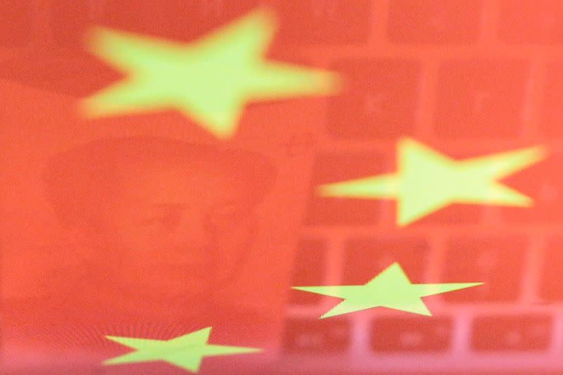 Illustration picture of China yuan banknote and computer keyboard reflected on Chinese flag