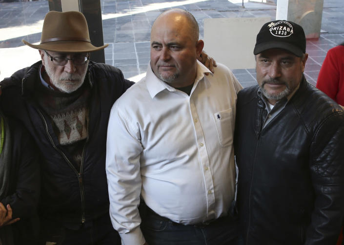 FILE - In this Jan. 9, 2019 file photo, Mexican writer and activist Javier Sicilia, from left, Julian LeBaron and brother Adrian, pose for photos during a press conference in Mexico City. Julian LeBaron, a prominent member of a community of U.S.-Mexican dual citizens living in northern Mexico that was shattered by the November massacre of three women and six children along a rural road has fled to the United States after an apparent threat on his life. (AP Photo/Marco Ugarte, File)