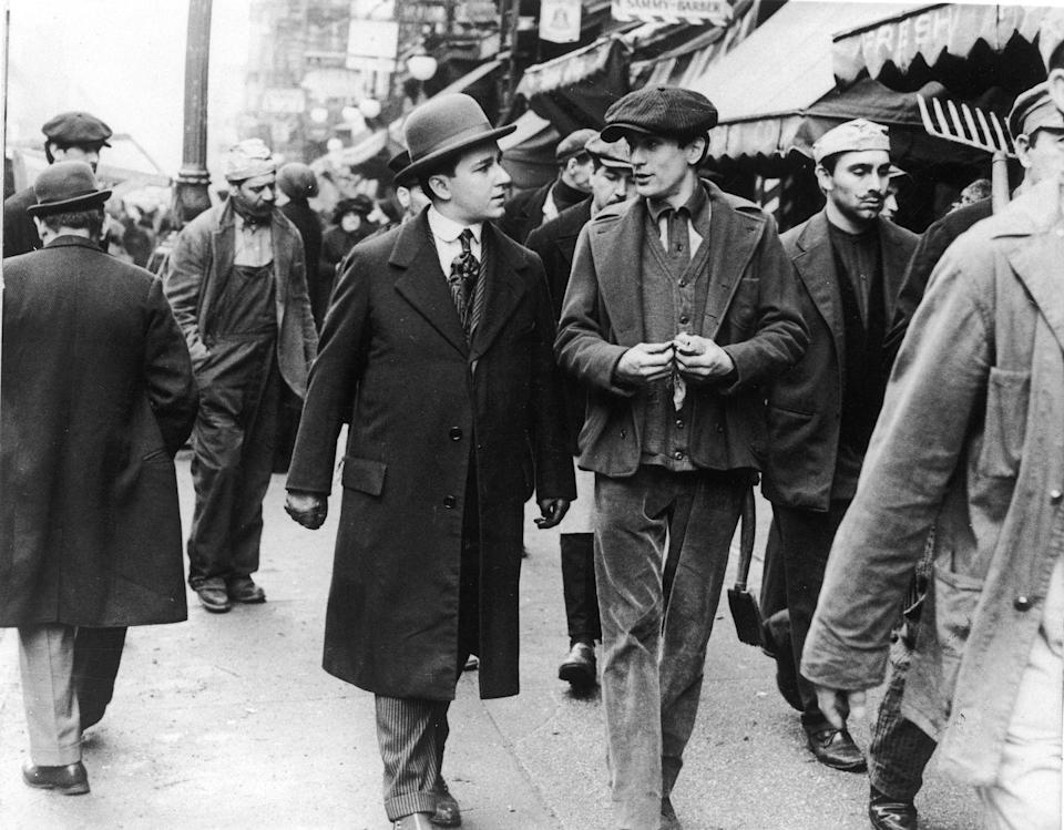 <p>De Niro is seen walking through the streets with a costar, while filming a scene in New York City's Lower East Side. </p>