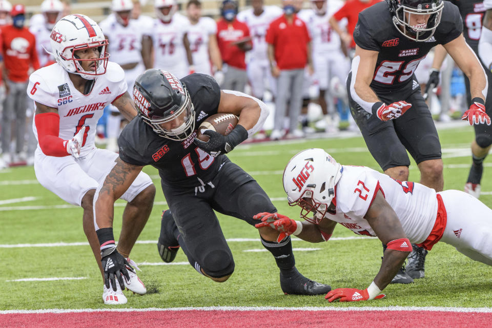 Louisiana-Lafayette running back Elijah Mitchell (15) scores a touchdown against South Alabama safety Dewayne Betts Jr. (27) in the first half an NCAA college football game in Lafayette, La., Saturday, Nov. 14, 2020. (AP Photo/Matthew Hinton)