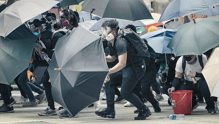 Demonstrators used umbrellas as shields last year, a tactic learnt during the Umbrella Movement of 2014