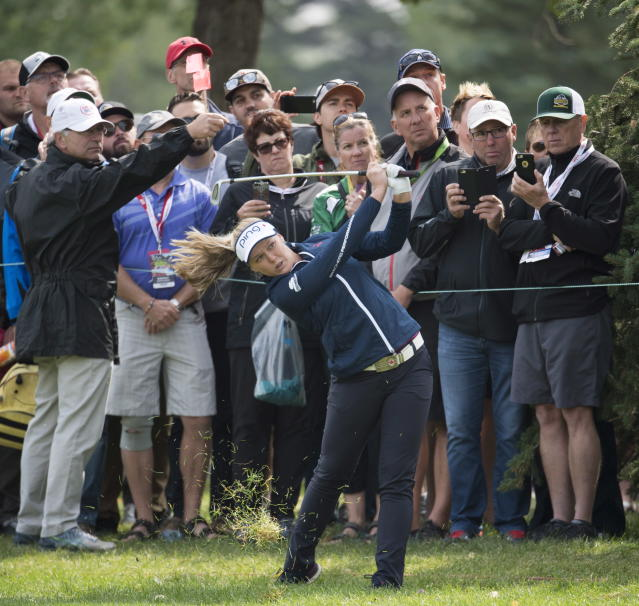 Brooke Henderson, of Smiths Falls, Ontario takes a shot out of the rough along the fifth fairway during the women's Canadian Open golf tournament in Regina, Saskatchewan, Saturday, Aug. 25, 2018. (Jonathan Hayward/The Canadian Press via AP)