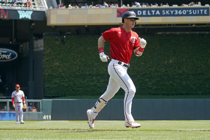 Minnesota Twins Brent Rooker jogs home on a solo home run off Los Angeles Angels pitcher Jaime Barria in the first inning of a baseball game, Sunday, July 25, 2021, in Minneapolis. (AP Photo/Jim Mone)