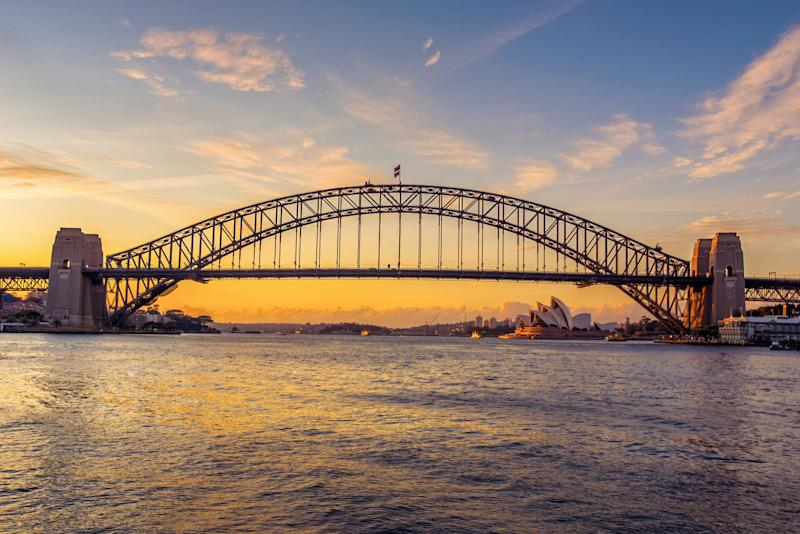 Iconic Sydney Harbour Bridge and Opera House taken at sunrise from Blues Point Reserve. Source: Getty
