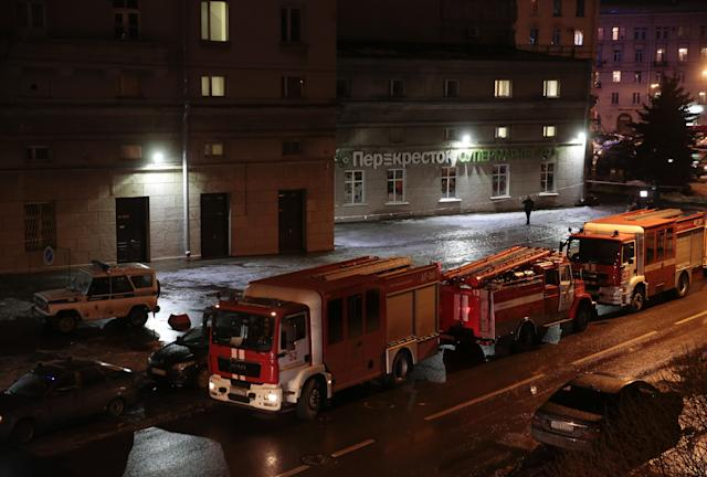 <p>Vehicles of emergency services are parked near a supermarket after an explosion in St. Petersburg, Russia, Dec. 27, 2017. (Photo: Anton Vaganov/Reuters) </p>