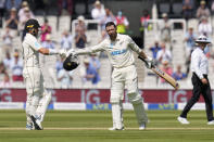 New Zealand's Devon Conway, centre, celebrates scoring 200 runs during the second day of the Test match between England and New Zealand at Lord's cricket ground in London, Thursday, June 3, 2021. (AP Photo/Kirsty Wigglesworth)