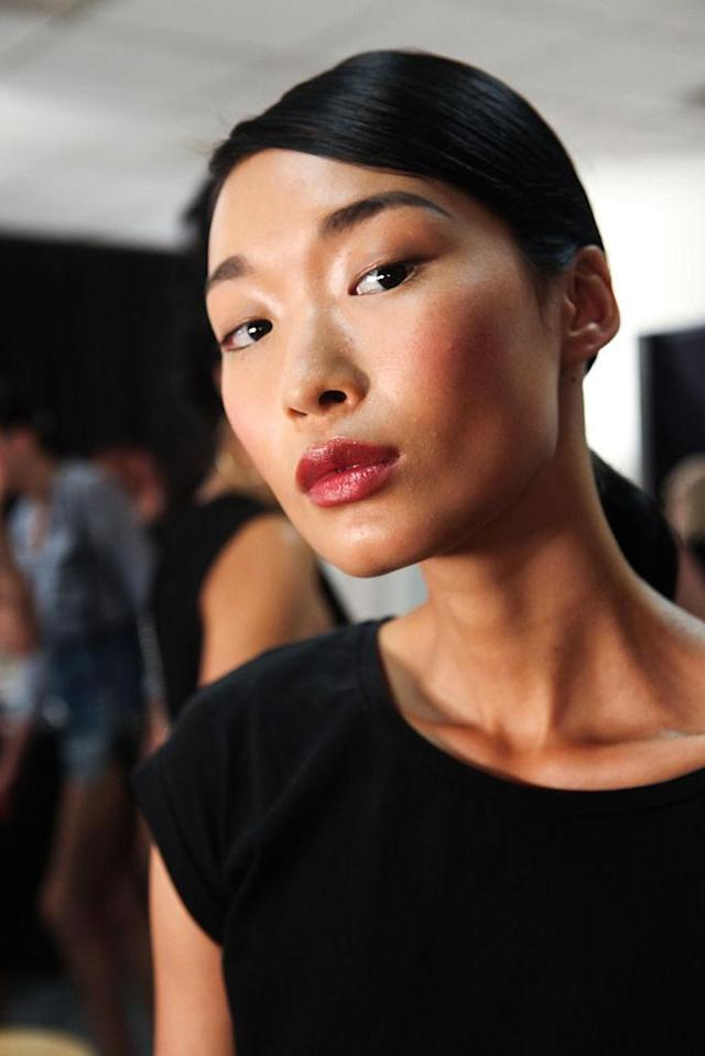<p>A glossy lip and deep side part are taking us back. (Photo: Getty Images) </p>