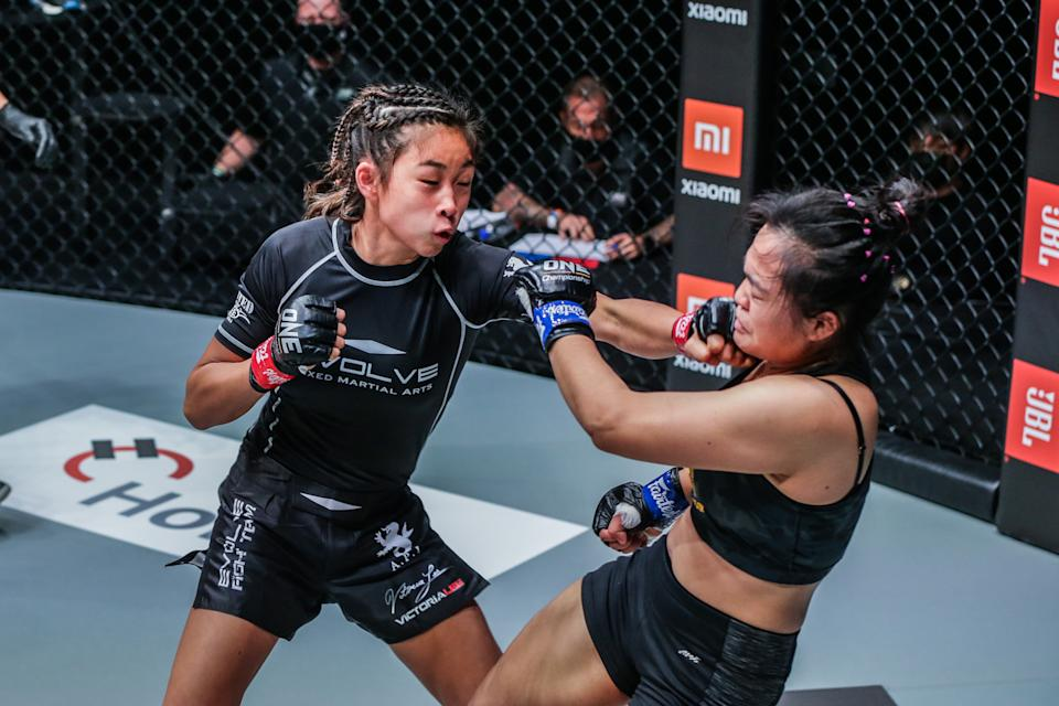 Victoria Lee (left) lands a jab on her Thai opponent Sunisa Srisen en route to winning her first professional MMA bout at ONE: Fists of Fury. (PHOTO: ONE Championship)
