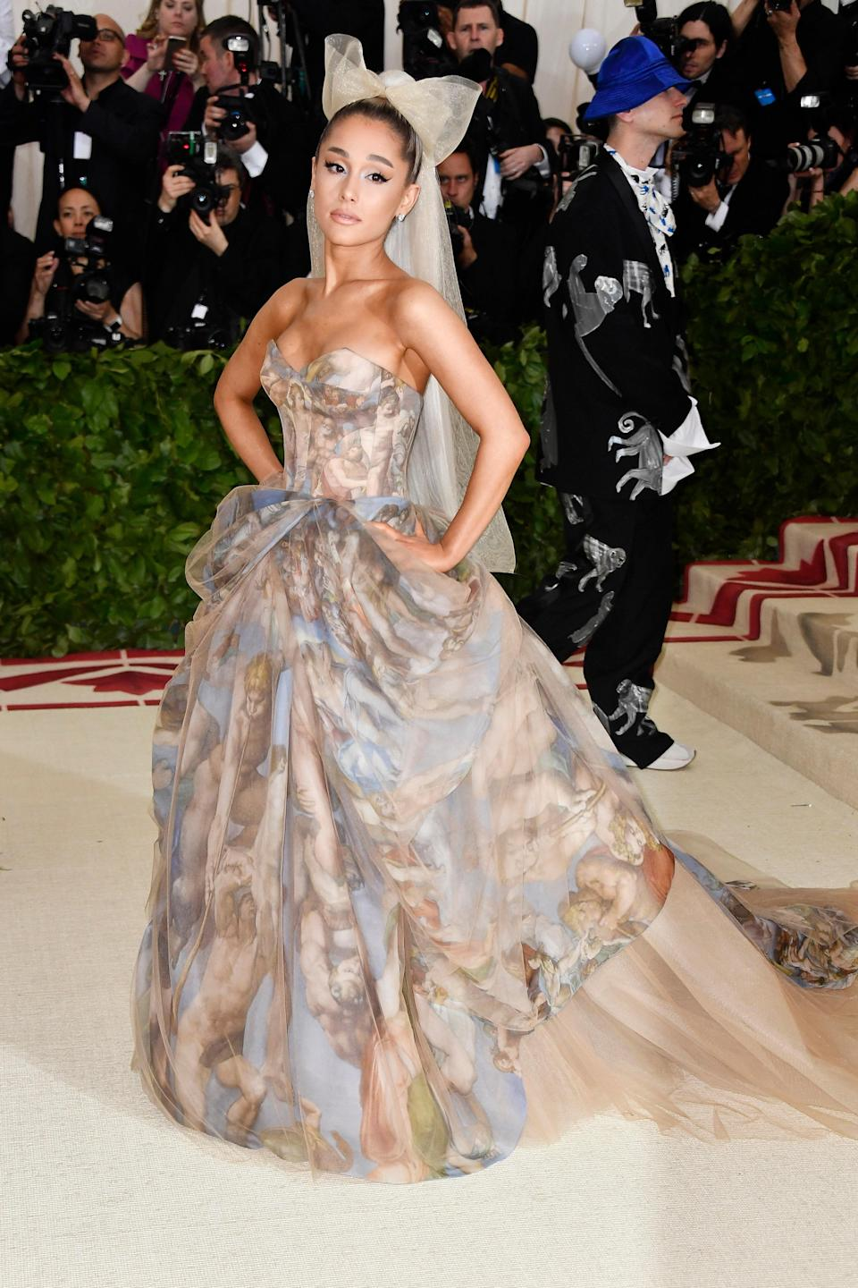 Grande clearly took notes for the 2018 Met Gala's Heavenly Bodies theme and arrived in a custom Vera Wang gown featuring an all-over print of the Sistine Chapel. Final score: a look that is truly heaven on earth.