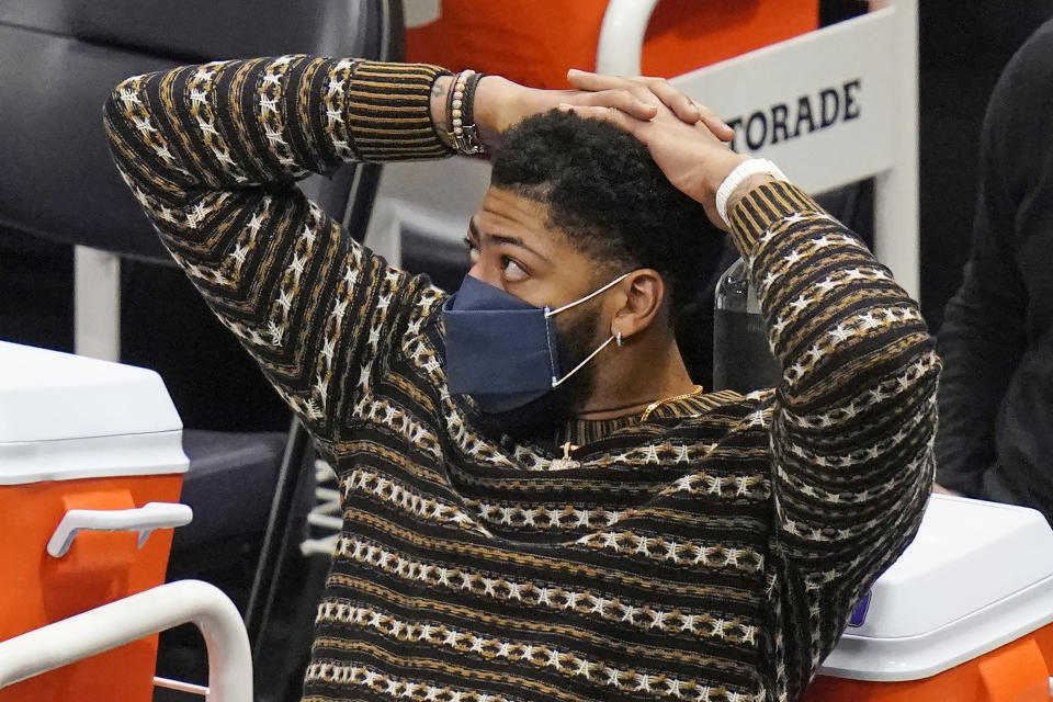 watches from the bench during the second half of the team's NBA basketball game against the Utah Jazz on Wednesday, Feb. 24, 2021, in Salt Lake City. (AP Photo/Rick Bowmer)