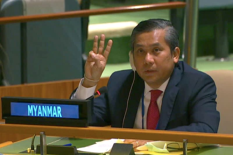 FILE PHOTO: Myanmar's ambassador to the United Nations Kyaw Moe Tun holds up three fingers at the end of his speech in New York
