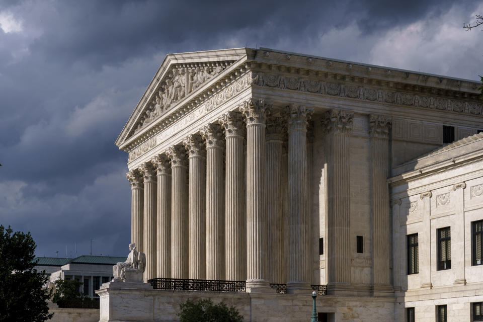 """FILE - This June 8, 2021 file photo shows the Supreme Court building in Washington. On Friday, Sept. 24, 2021, The Associated Press reported on stories circulating online incorrectly asserting that after a legal challenge from Robert F. Kennedy Jr. and a group of scientists, the U.S. Supreme Court ruled COVID-19 vaccines are unsafe and """"canceled universal vaccination."""" While Kennedy said he has been a part of more than 30 lawsuits on the subject of vaccine safety, those are at different stages of the judicial process and none have appeared before the Supreme Court. (AP Photo/J. Scott Applewhite)"""
