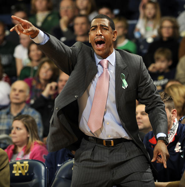 Connecticut coach Kevin Ollie shouts instructions to his team during the first half of an NCAA college basketball game against Notre Dame, Saturday, Jan. 12, 2013, in South Bend, Ind. (AP Photo/Joe Raymond)