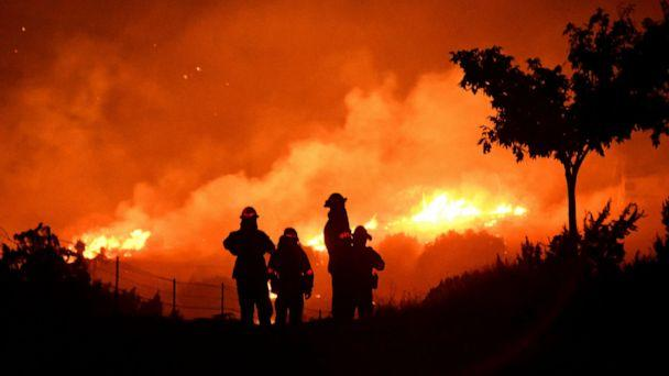 PHOTO: Los Angeles County firefighters keep watch on the Bobcat Fire as it burns through the night in Juniper Hills, California, on September 19, 2020. (Gene Blevins/Reuters)