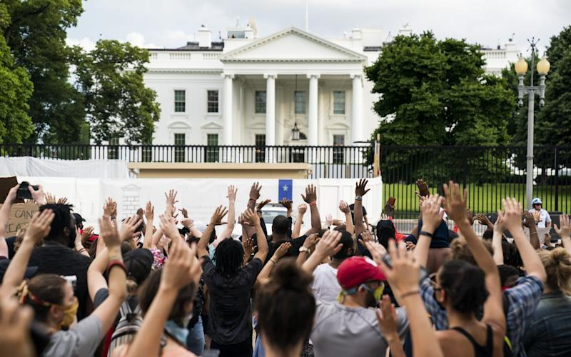 The White House went into lockdown in response to the protest - EPA
