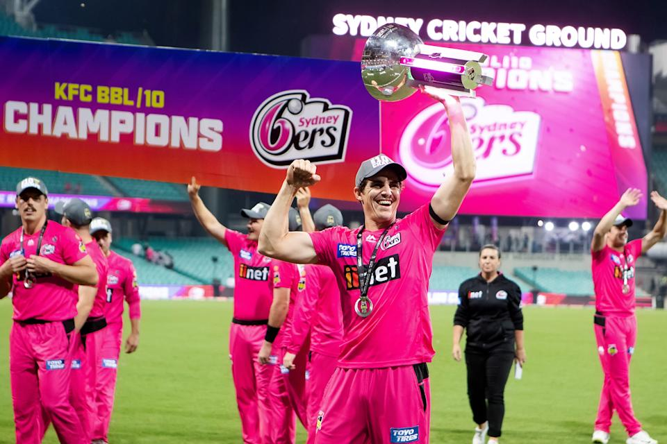 SYDNEY, AUSTRALIA - FEBRUARY 06: Sydney Sixers player Sean Abbott shows off the trophy during the Big Bash League final cricket match between Sydney Sixers and Perth Scorchers at the Sydney Cricket Ground on February 06, 2021 in Sydney, Australia. (Photo by Pete Dovgan/Speed Media/Icon Sportswire via Getty Images)