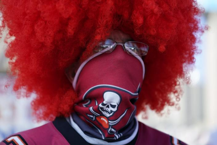 A Tampa Bay Buccaneers fan arrives before the NFL Super Bowl 55 football game between the Kansas City Chiefs and Tampa Bay Buccaneers, Sunday, Feb. 7, 2021, in Tampa, Fla. (AP Photo/Mark Humphrey)