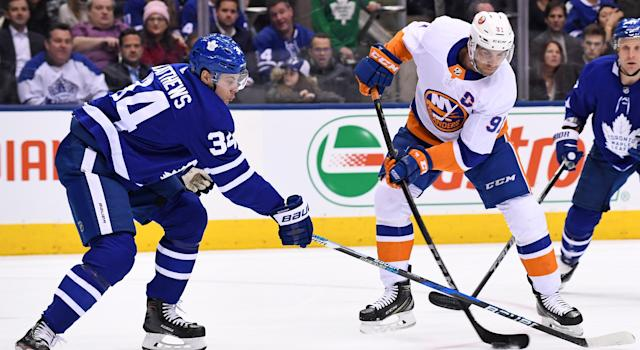 Auston Matthews and John Tavares fight for the puck during a regular season game between the New York Islanders and Toronto Maple Leafs on January 31, 2018. (Photo by Gerry Angus/Icon Sportswire via Getty Images)
