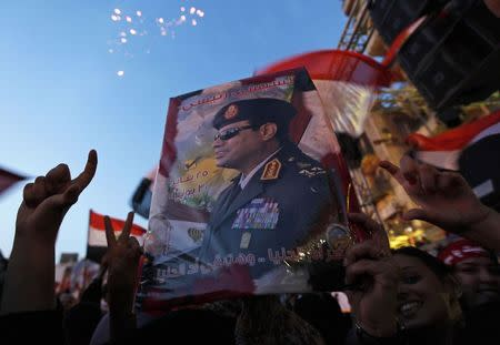 File photo of Egyptians gathering in Tahrir square to celebrate former Egyptian army chief al-Sisi's victory in the presidential vote in Cairo