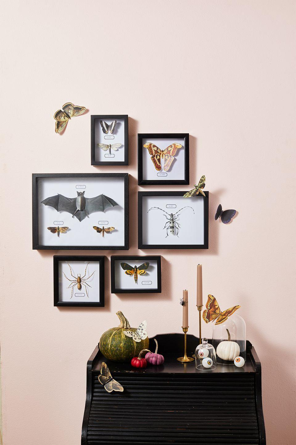 """<p>Replace a wall of family photos with a creepy crawly gallery wall. Print out our Halloween clip art of bugs and bats on card stock, cut them out and display in frames. </p><p><em><a href=""""https://www.goodhousekeeping.com/holidays/halloween-ideas/a33564450/gh-halloween-artwork-calligraphy-templates/"""" rel=""""nofollow noopener"""" target=""""_blank"""" data-ylk=""""slk:Get the printables »"""" class=""""link rapid-noclick-resp"""">Get the printables »</a></em></p>"""