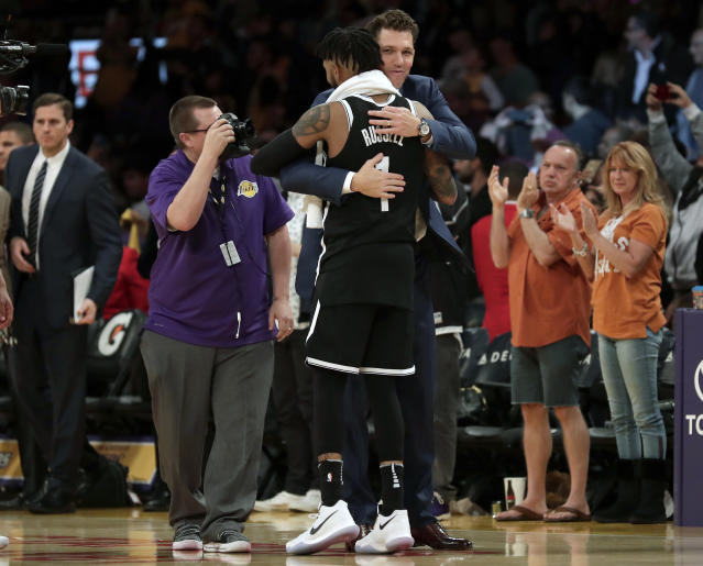 "Lakers coach Luke Walton gave Nets guard <a class=""link rapid-noclick-resp"" href=""/nba/players/5433/"" data-ylk=""slk:D'Angelo Russell"">D'Angelo Russell</a> a hug during Russell's return to L.A. earlier this month. (AP)"