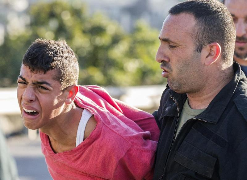 Israeli security forces detain an Arab-Israeli youth during clashes between the two groups in Kfar Kana, Israel, on November 9, 2014 (AFP Photo/Jack Guez)