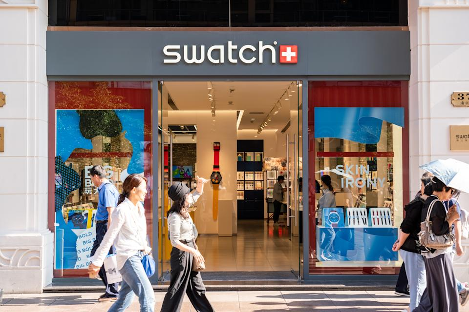 SHANGHAI, CHINA - 2019/09/20: Pedestrians walk past a Swatch store in Shanghai. A Swiss watchmaker. (Photo by Alex Tai/SOPA Images/LightRocket via Getty Images)