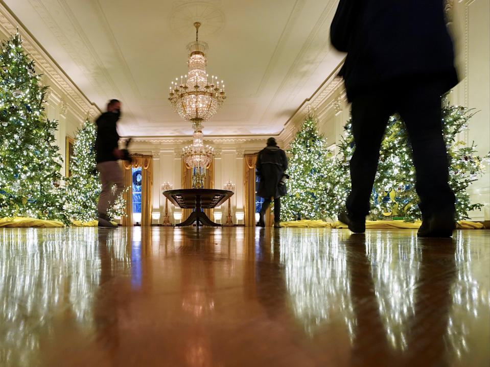 <p>White House parties are due to begin, despite health warnings</p> (REUTERS)
