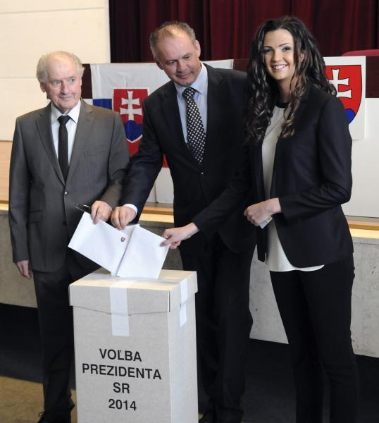 Presidential candidate, businessman and philanthropist Andrej Kiska, center, his father Andrej Kiska Sr., left, and his daughter Natalie Kiskova, right, cast their ballots in the second round of the presidential elections in Poprad, Slovakia, Saturday, March 29, 2014. Kiska´s rival is Slovak Prime Minister Robert Fico, (AP Photo,CTK/Alexander Supik) SLOVAKIA OUT