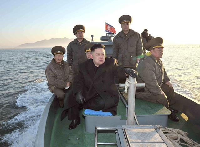 "In this March 11, 2013 photo released by the Korean Central News Agency (KCNA) and distributed March 12, 2013 by the Korea News Service, North Korean leader Kim Jong Un rides on a boat, heading for the Wolnae Islet Defense Detachment, North Korea, near the western sea border with South Korea. North Korea's young leader urged front-line troops to be on ""maximum alert"" for a potential war as a state-run newspaper said Pyongyang had carried out a threat to cancel the 1953 armistice that ended the Korean War. (AP Photo/KCNA via KNS) JAPAN OUT UNTIL 14 DAYS AFTER THE DAY OF TRANSMISSION"