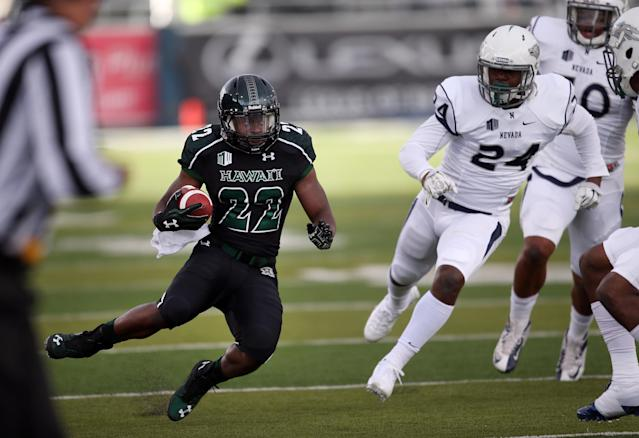 Hawaii's Diocemy Saint Juste (22) looks for an opening in the Nevada defence during the first half of an NCAA college football game in Reno, Nev., on Saturday, Sept. 21, 2013. (AP Photo/Cathleen Allison)