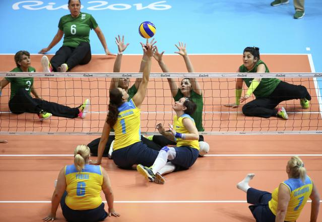 2016 Rio Paralympics - Sitting Volleyball - Women's Bronze Match - Riocentro Pavilion 6 - Rio de Janeiro, Brazil, 17/09/2016. Margaryta Pryvalykhina and Tetyana Huranska (UKR) of Ukraine and Janaina Petit Cunha and Adria Jesus da Silva (BRA) of Brazil in action. REUTERS/Pilar Olivares FOR EDITORIAL USE ONLY. NOT FOR SALE FOR MARKETING OR ADVERTISING CAMPAIGNS.