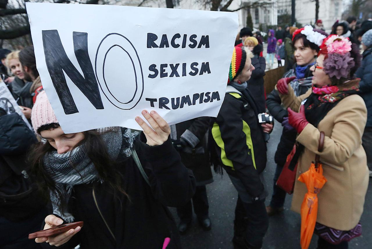 <p>Some 200 activists of women's organizations and women's rights slogans walk from the office of Prime Minister to the U.S. Embassy in Warsaw, Poland, Saturday, Jan. 21, 2017, in support of the Women's March in Washington and protests around the globe saying they were concerned about the rhetoric that was raised in President Donald Trump's campaign. (AP Photo/Czarek Sokolowski) </p>