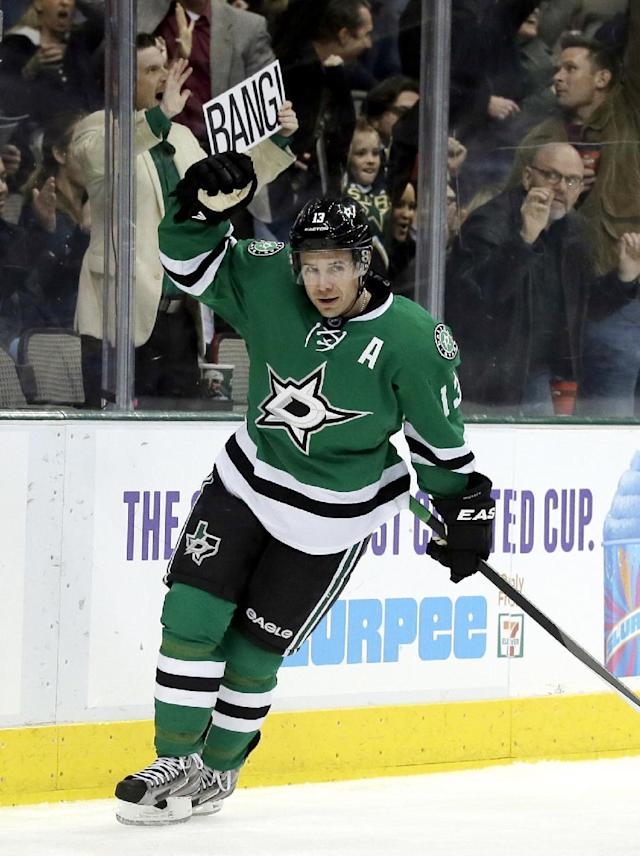 Dallas Stars left wing Ray Whitney celebrates his goal against the Colorado Avalanche in the first period of an NHL hockey game, Tuesday, Dec. 17, 2013, in Dallas. (AP Photo/Tony Gutierrez)