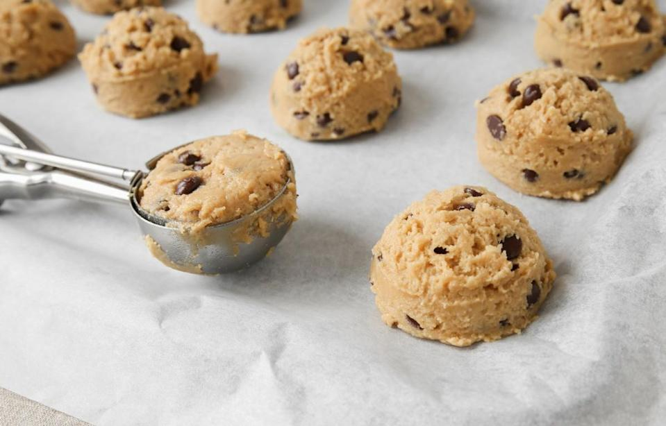 """<p>If you're making cupcakes or cookies, you want them all to be perfectly even and the same size. Cover an ice cream scoop, tablespoon or melon baller with cooking spray and use it to scoop your batter into a cupcake tray or cookie tin. Not only will this make everything the same size, but it's a faster and neater way to divide up the batter. With this helpful hack, you'll be ditching <a href=""""https://www.thedailymeal.com/eat/chocolate-chip-cookies-ranked-gallery?referrer=yahoo&category=beauty_food&include_utm=1&utm_medium=referral&utm_source=yahoo&utm_campaign=feed"""" rel=""""nofollow noopener"""" target=""""_blank"""" data-ylk=""""slk:store-bought cookies"""" class=""""link rapid-noclick-resp"""">store-bought cookies</a> in no time.</p>"""