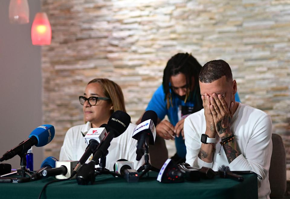 Mother Keila Ortiz, left, and father Jose Antonio Rodriguez, right, offer a press conference at the wake of their daughter Keishla RodriguezAP