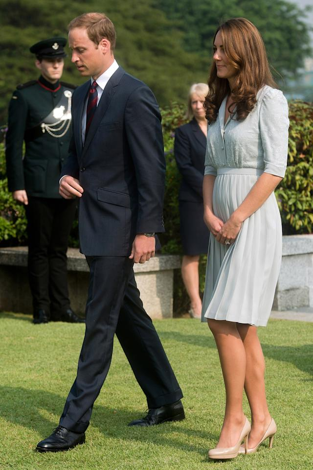 FILE - In this Thursday, Sept. 13, 2012 file photo, Britain's Prince William and his wife Kate, the Duke and Duchess of Cambridge, walk together as they visit the Kranji Commonwealth War Memorial in Singapore. Prince William and his wife Catherine are expecting their first child. St. James's Palace announced the pregnancy Monday, saying that the Duchess of Cambridge, formerly known as Kate Middleton has a severe form of morning sickness and is currently in a London hospital. William is at his wife's side. (AP Photo/Nicolas Asfouri, Pool, File)