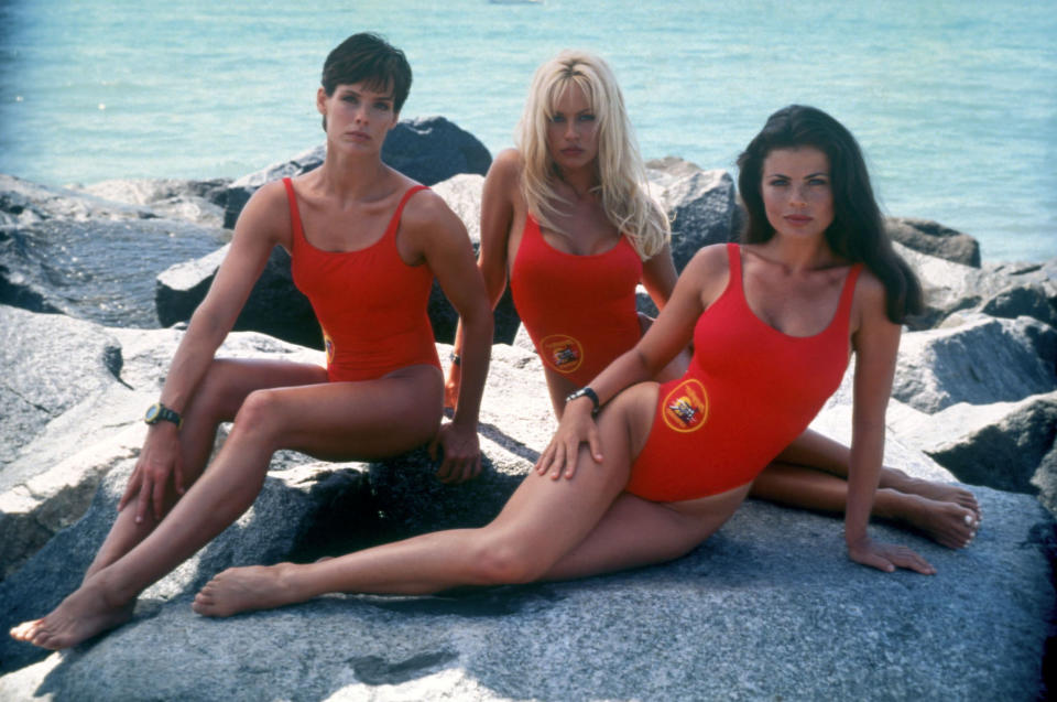 Paul (with co-stars Pamela Anderson and Yasmine Bleeth) says she requested to wear a swimsuit even though her character was originally given a more conservative uniform. (Photo: Fremantle)