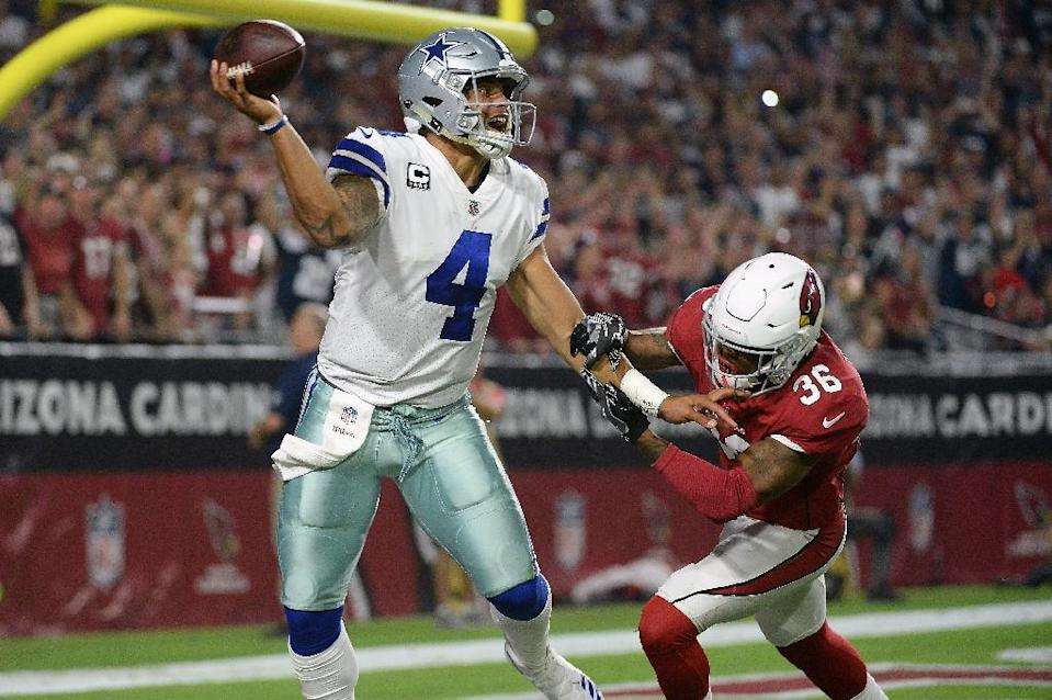 Quarterback Dak Prescott of the Dallas Cowboys throws a pass under pressure from safety Budda Baker of the Arizona Cardinals during the second half, at the University of Phoenix Stadium in Glendale, Arizona, on September 25, 2017 (AFP Photo/Jennifer Stewart)
