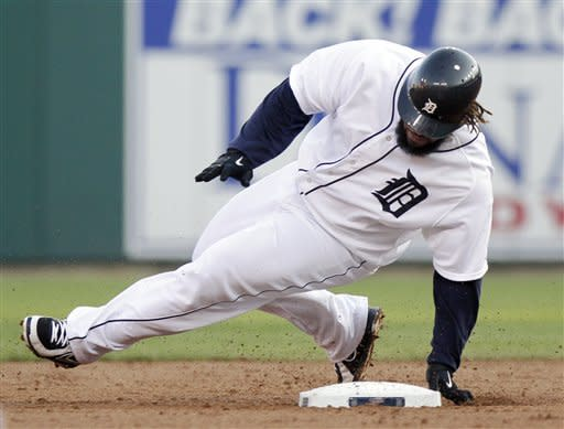 Detroit Tigers' Prince Fielder tries to grab second base but slides past it before being tagged out by Los Angeles Angels shortstop Erick Aybar during the second inning of a baseball game Saturday, Aug. 25, 2012, in Detroit. Fielder was trying to stretch a hit into a double on the play. (AP Photo/Duane Burleson)