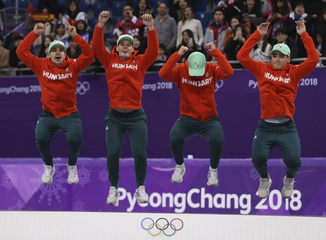 Short Track Speed Skating Events - Pyeongchang 2018 Winter Olympics - Men's 5000m Relay Final - Gangneung Ice Arena - Gangneung, South Korea - February 22, 2018 - Gold medallists Viktor Knoch, Csaba Burjan, Liu Shaoang and Sandor Liu Shaolin of Hungary jump in celebration on the podium. REUTERS/Damir Sagolj