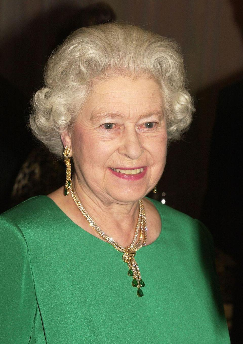 """<p>Queen Elizabeth wore the gold Delhi Durbar set to a royal gala in Wales in 2004. The featured emeralds had once <a href=""""https://www.harpersbazaar.com/wedding/bridal-fashion/g23656976/best-royal-family-jewelry-of-all-time/?slide=24"""" rel=""""nofollow noopener"""" target=""""_blank"""" data-ylk=""""slk:belonged"""" class=""""link rapid-noclick-resp"""">belonged</a> to Queen Mary's grandmother. <br></p>"""