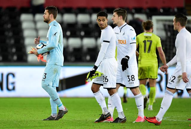 Soccer Football - FA Cup Fourth Round Replay - Swansea City vs Notts County - Liberty Stadium, Swansea, Britain - February 6, 2018 (L - R) Swansea City's Kristoffer Nordfeldt, Kyle Naughton, and Adnan Maric after the match REUTERS/Rebecca Naden