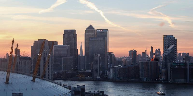 Canary Wharf and the city are seen at sunset in London, December 14, 2016.