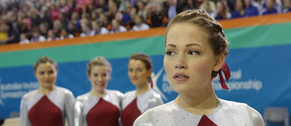 """<p><strong>Netflix's Description:</strong> """"A teenager who gave up her spot in an elite U.S. gymnastics program when her family moved to Australia enters a competition to help a new friend.""""</p> <p><a href=""""https://www.netflix.com/title/80187107"""" class=""""link rapid-noclick-resp"""" rel=""""nofollow noopener"""" target=""""_blank"""" data-ylk=""""slk:Stream Raising the Bar on Netflix!"""">Stream <strong>Raising the Bar</strong> on Netflix!</a></p>"""