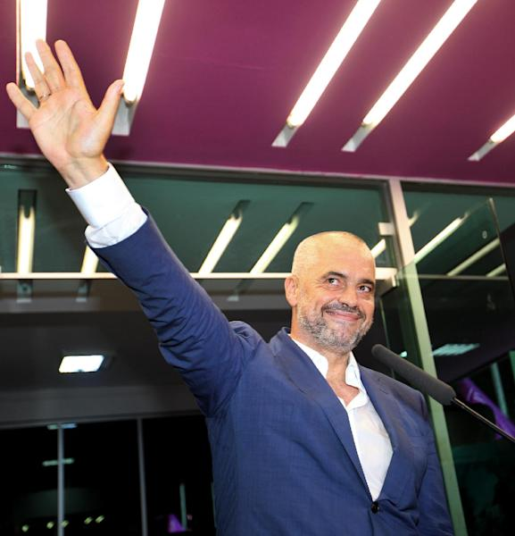 Opposition Socialist Party leader Edi Rama gestures as he gives his victory speech at party headquarters in Tirana, Albania, calling on the governing Democratic Party of Prime Minister Sali Berisha to acknowledge its loss, after counting results show a clear lead of his party, Tuesday, June 25, 2013. Albania's national elections were seen as key test for the country's hopes for closer ties with the European Union. (AP Photo/Hektor Pustina)