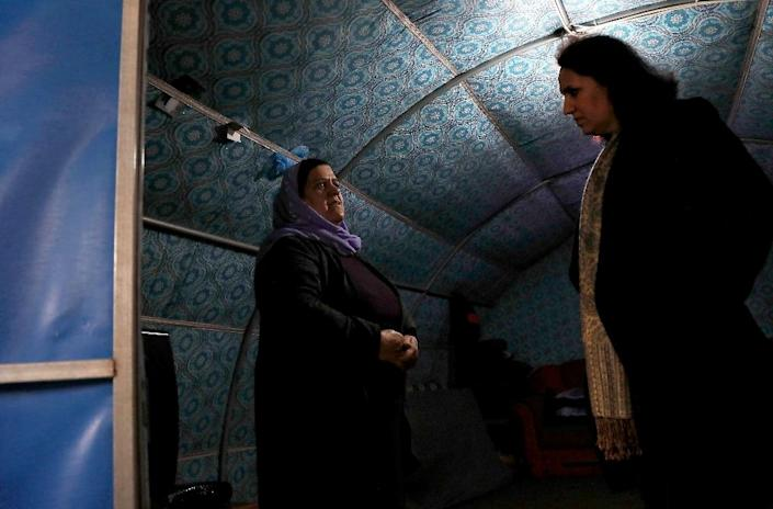Living in camps slows her patients' mental recovery, Nagham Hasan said (R) (AFP Photo/SAFIN HAMED)