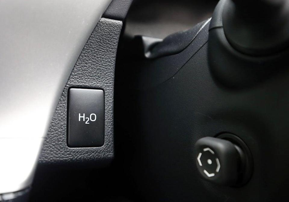 The button to disperse water from the exhaust pipe of the first mass production dedicated hydrogen fuel cell vehicle (Steve Parsons/PA) (PA Archive)