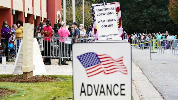 PHOTO: Voters line up to cast their election ballot at a Cobb County polling station during early voting in Marietta, Ga., Oct. 13, 2020. (Elijah Nouvelage/Reuters, FILE)